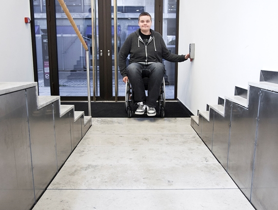 The Stepless SLP C platform lift is a bespoke model designed for embedding in a flight of stairs or steps, with a platform at the upper level.
